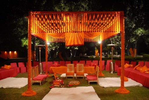 traditional mandap design fully decorated with marigold flowers