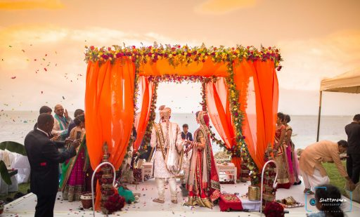 Orange beach wedding mandap decorated with Roses & Ferns