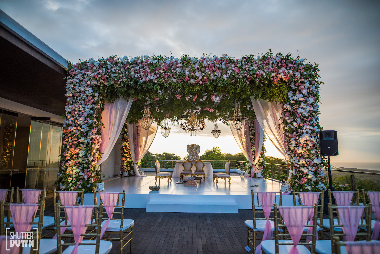 open terrace mandap with floral decoration and Chandelier