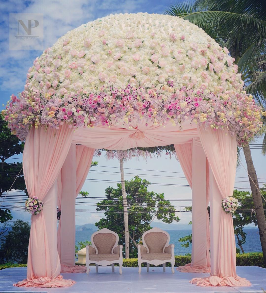 Dome shaped White and pink flower mandap with Baby Pink Drapes