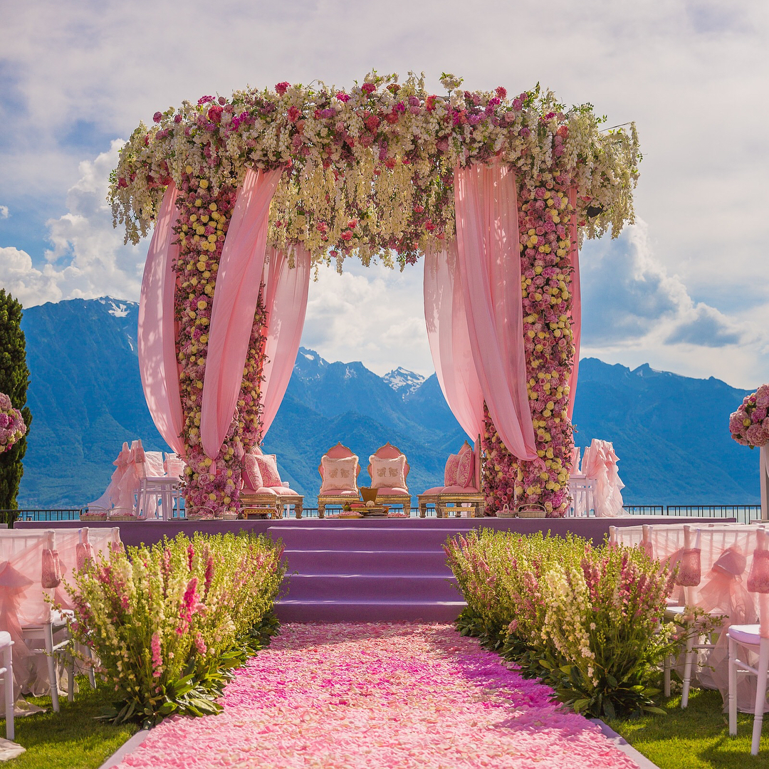 mandap decoration image clicked in switzerland - mandal decorated with flowers and pink drapes