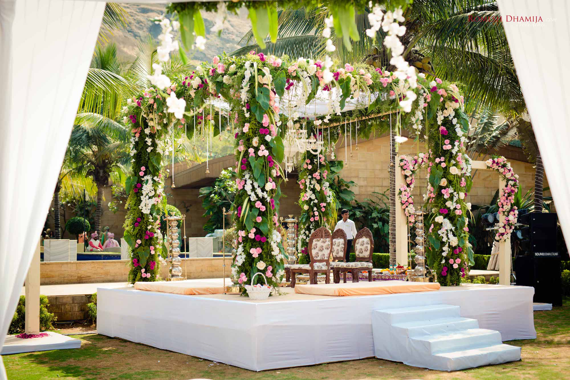 Outdoor Mandap decoration with Foliage and flowers of Violet, Pastel Pink & White colour