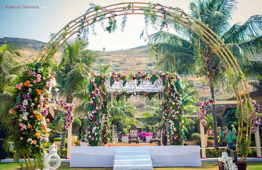 Latest wedding Mandap Decor Trend -  decoration with Foliage and colourful flowers