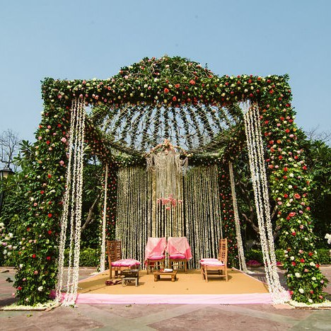 Garden Theme floral Dome shaped Mandap with Tuberoses' Curtains & Chandelier