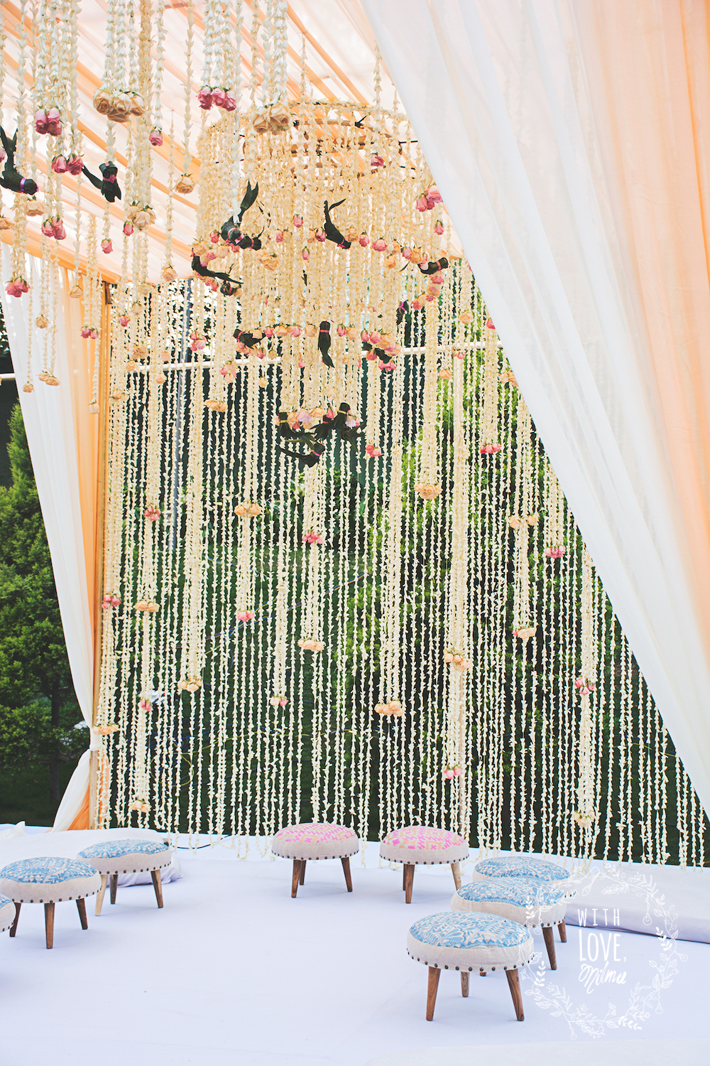 Simple mandap decoration with curtain of Tuberoses and Floral Chandelier plus with cushion printed mandap chairs