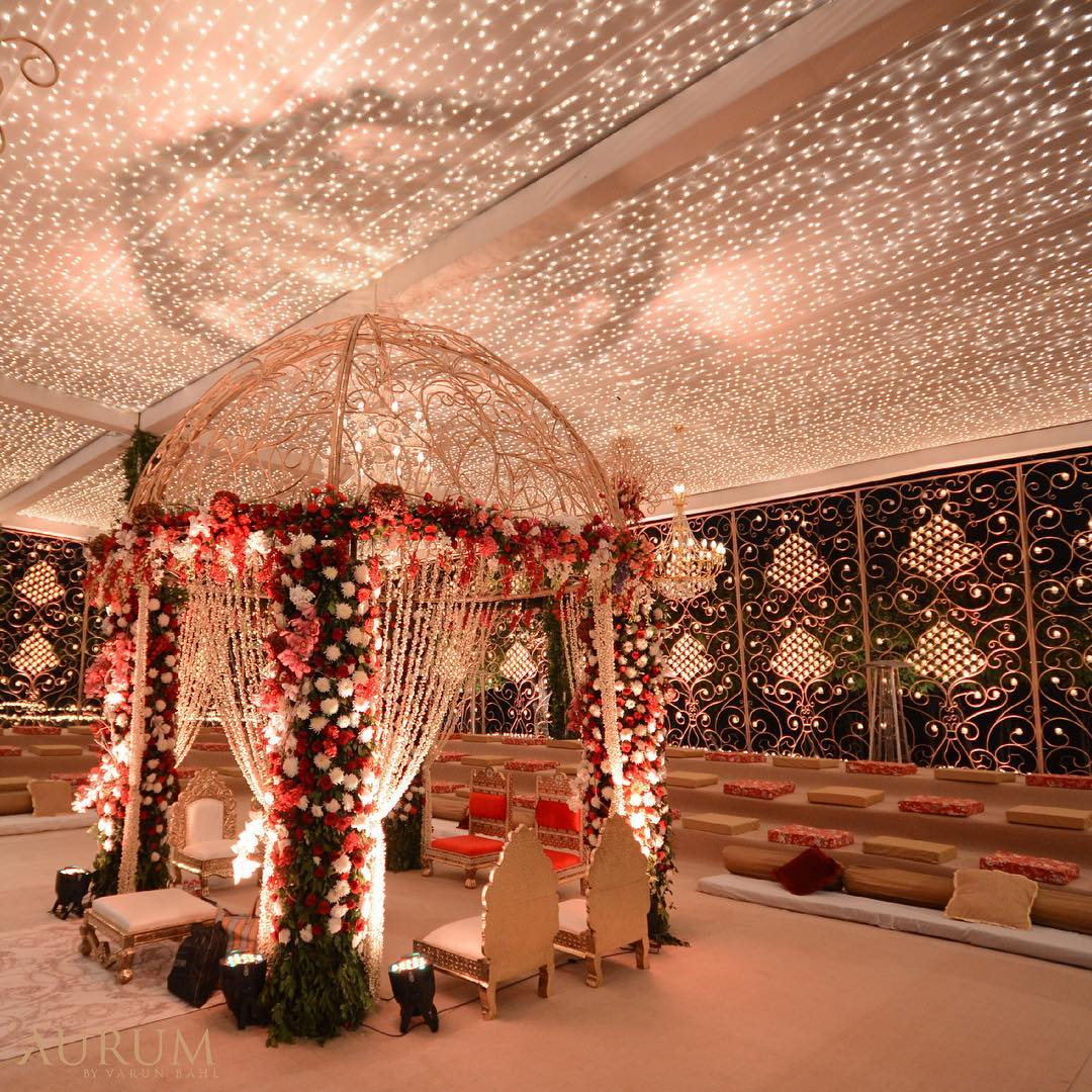 Fancy Dome-Shaped Mandap with Fairy Lights Ceiling and with pink, red and whites roses for decoration
