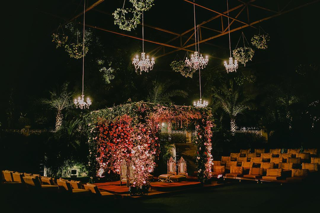 Rustic Style wedding Mandap decoration with Crystal & Foliage Chandeliers and flowers