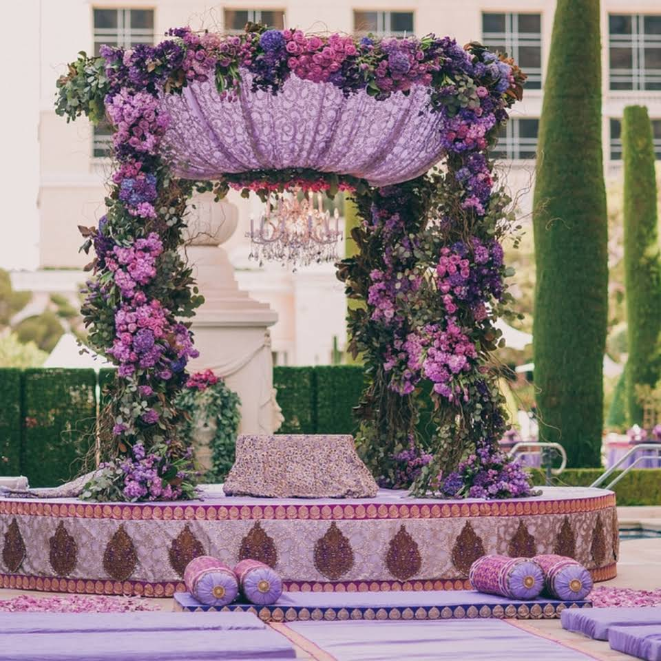 Gorgeous Mandap for a Sikh Wedding decorated with Shades of Violet flowers and a Crystal Chandelier