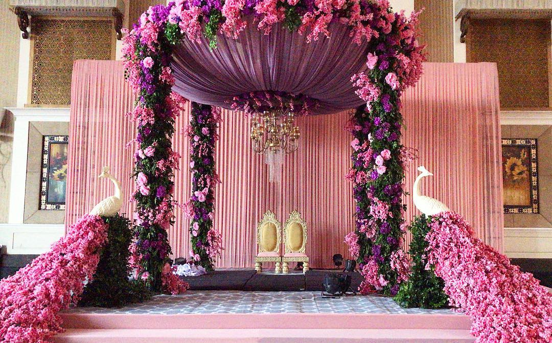 Traditional Indoor mandap decoration with Peacock Elements & Gold Ornate Mandap Chairs