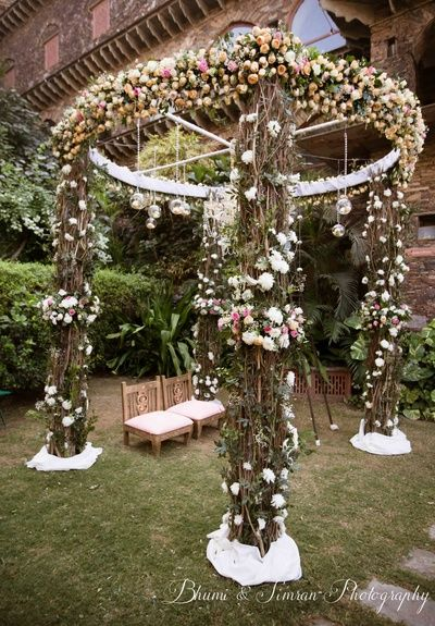Round Open wedding Mandap decorated with Pastel flowers and Hanging Orbs plus golden and white wedding mandap chairs