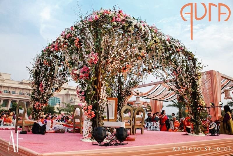 Modern design outdoor wedding Mandap with Greenery, Twigs and some Pastel Flowers