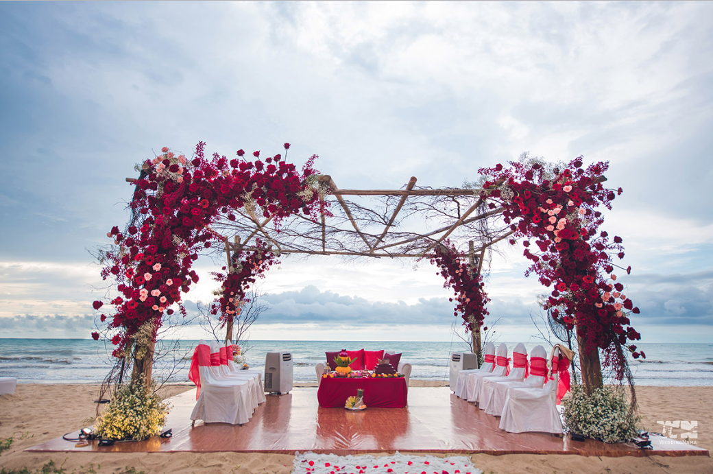 open wedding mandap decorated in rustic style with roses and twigs