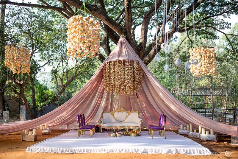 Unique Mandap Design in Glamping Style with cream and golden mandal sofa chair