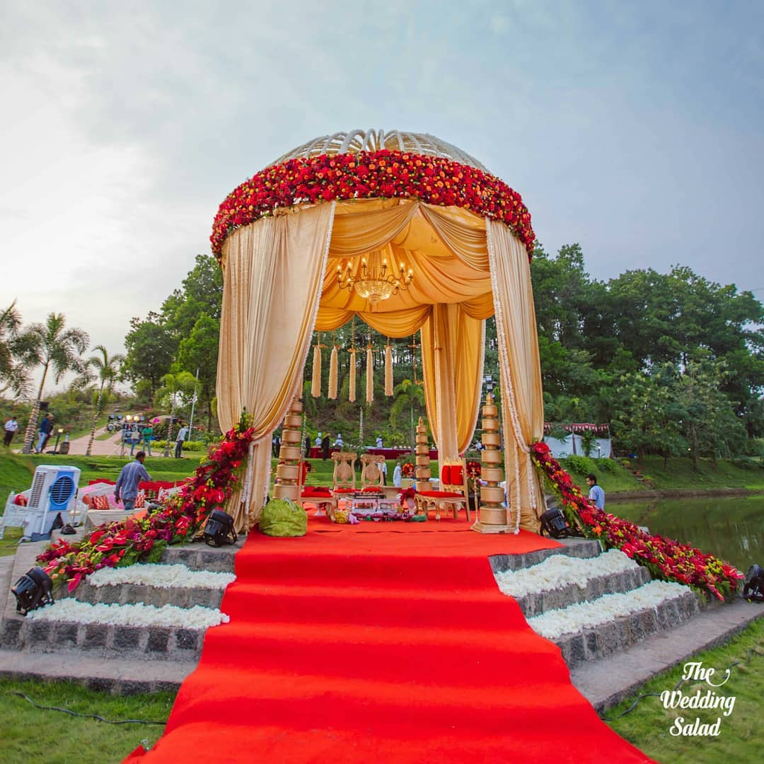 royal wedding mandap decoration with Red Flowers & Golden Drapes