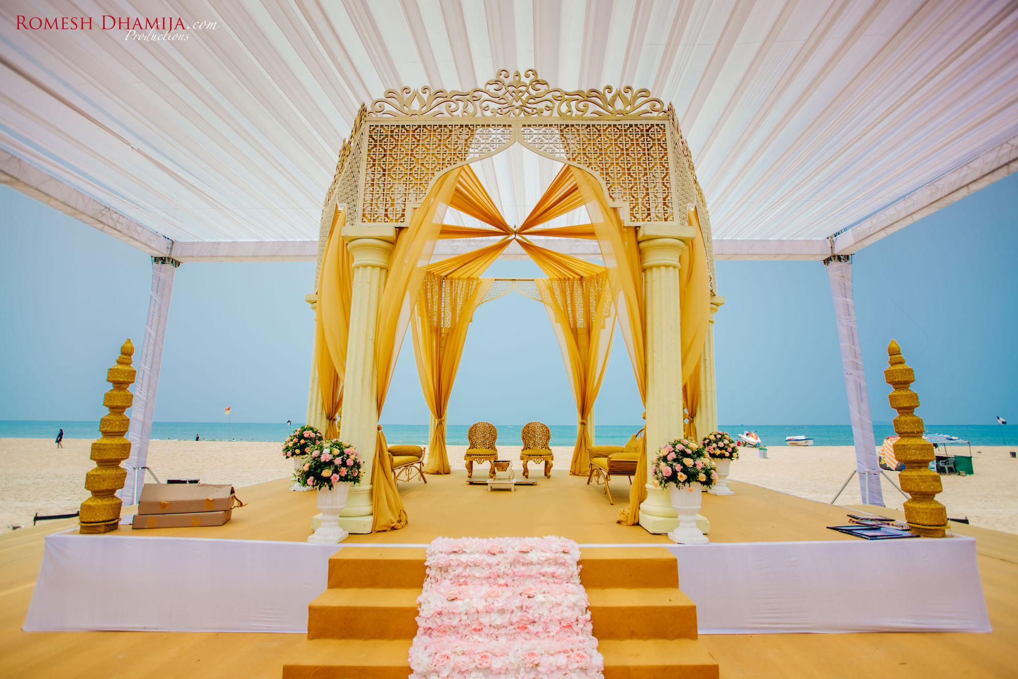Yellow and gold simple mandap at beach wedding