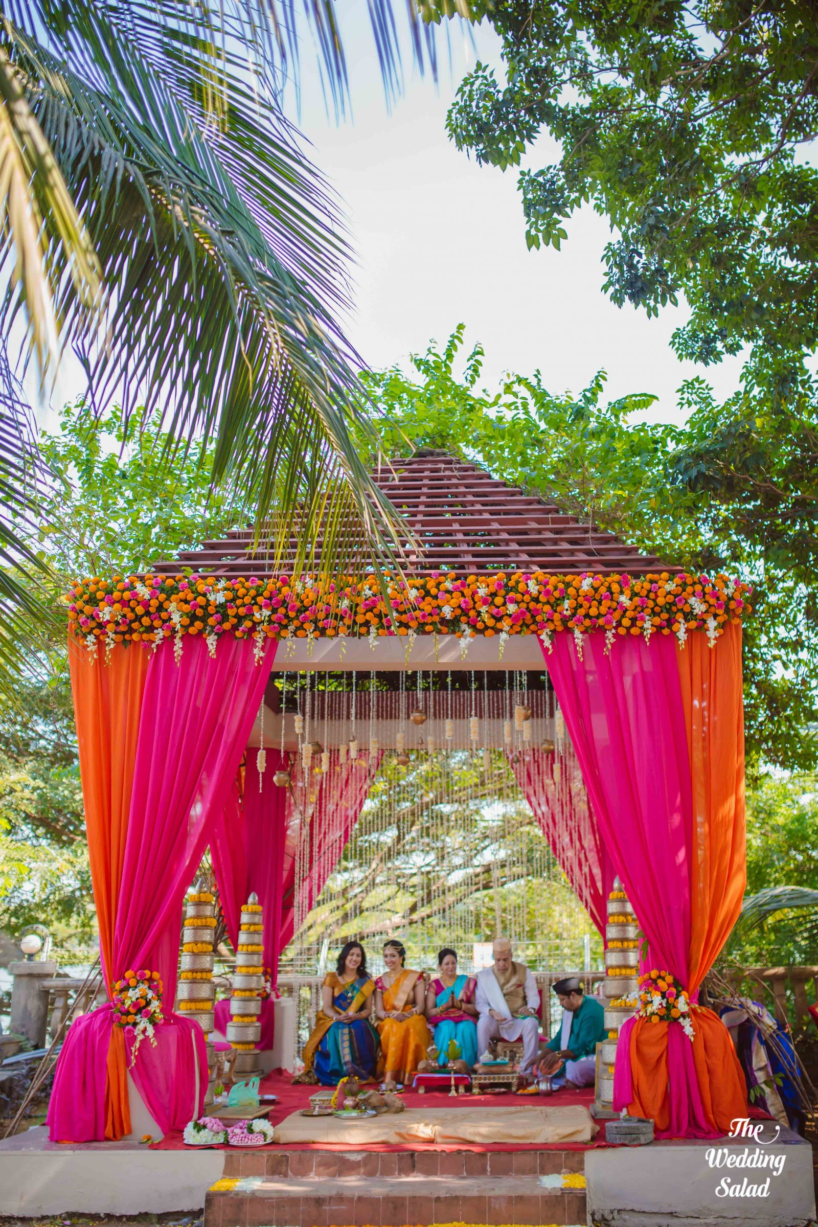 south indian wedding mandap designs with floral decoration and pink & orange drapes