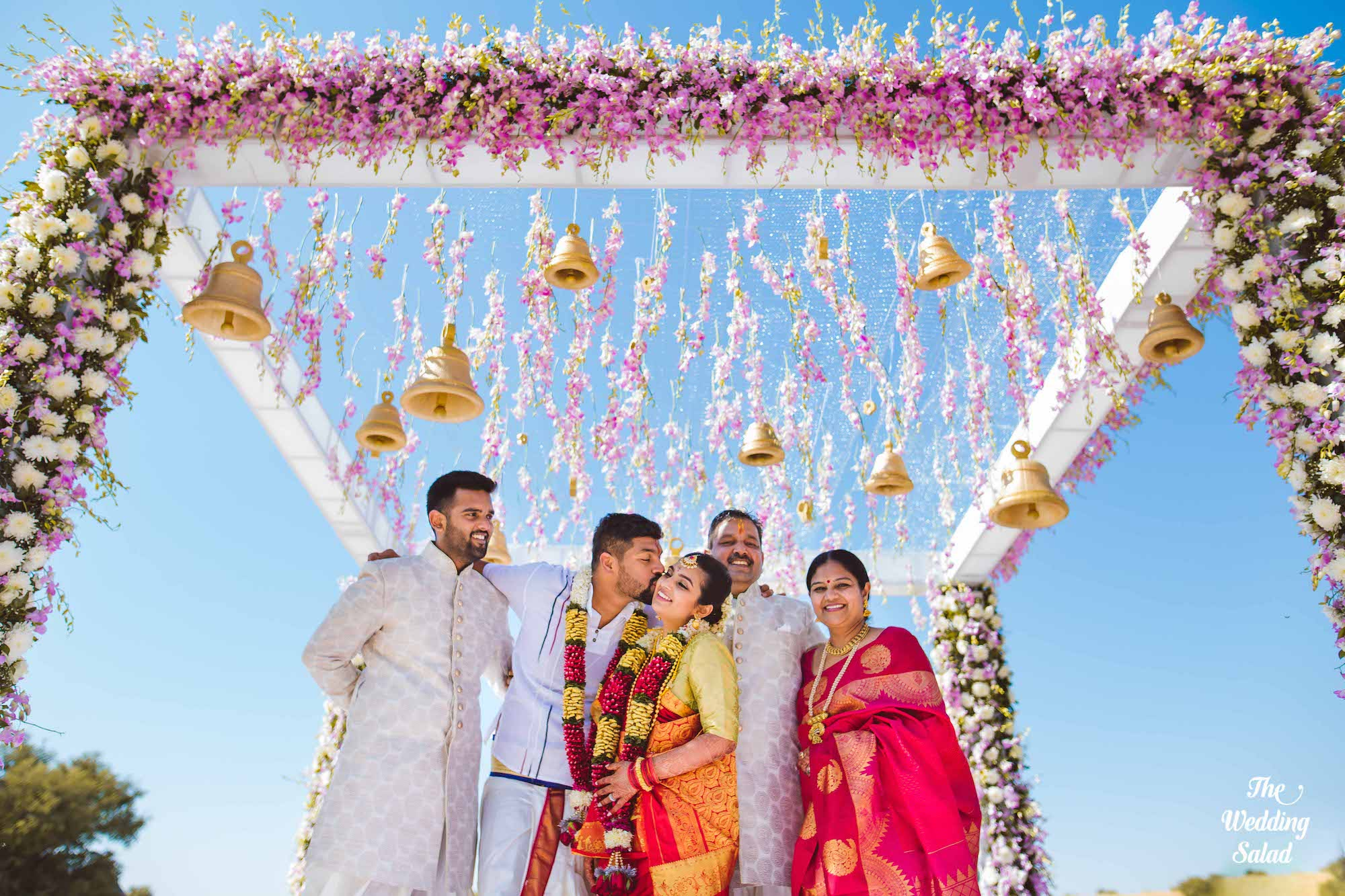 South Indian wedding Mandap decorated with Orchids & Temple Bells