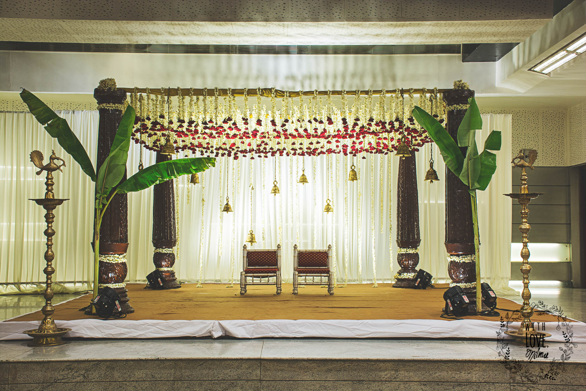 Traditional Wooden Mandap Design with Banana Leaves, Temple Bells & Flowers Ceiling for south Indian wedding