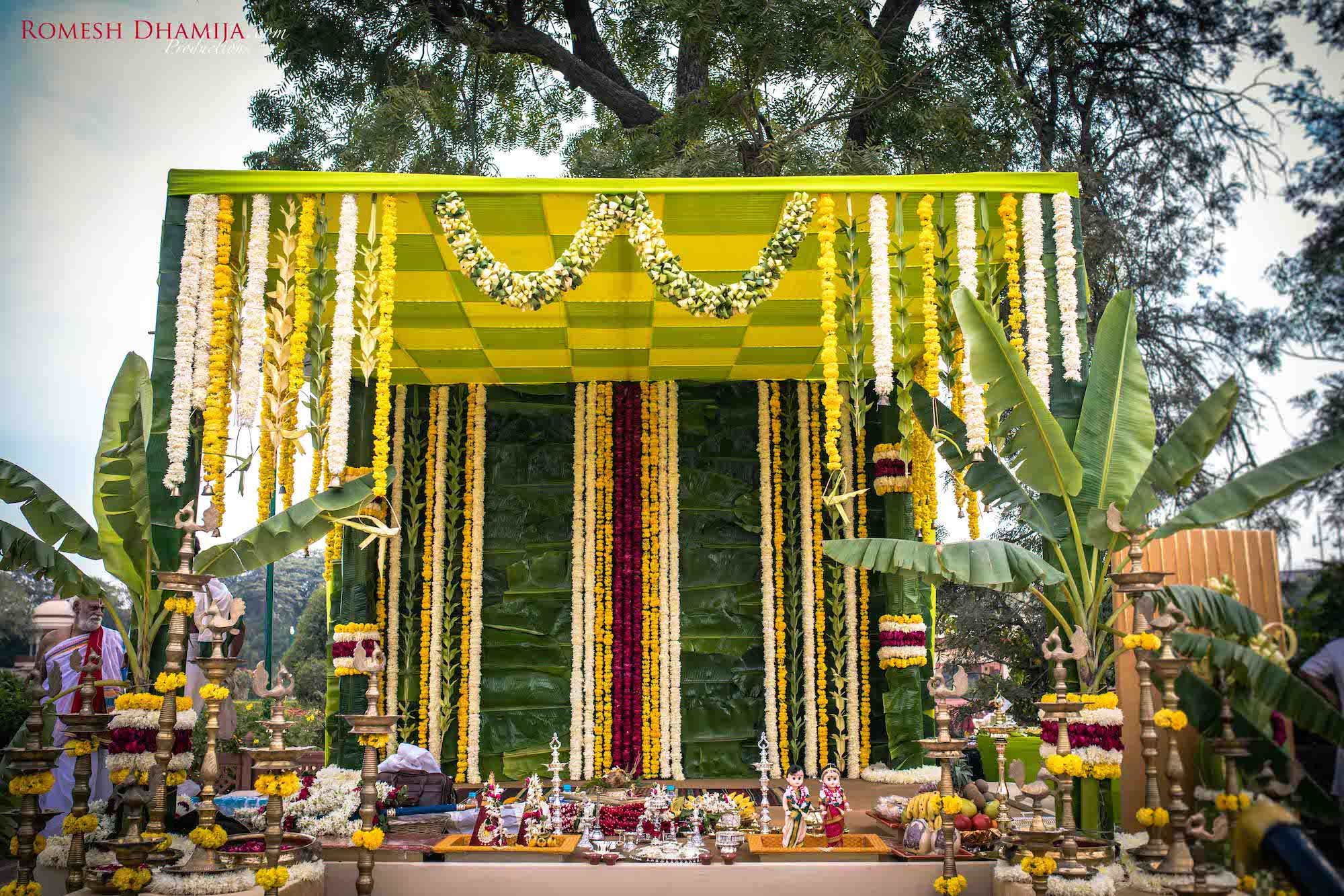 Traditional mandal design decorated with Yellow & Green flowers & Chequered Ceiling