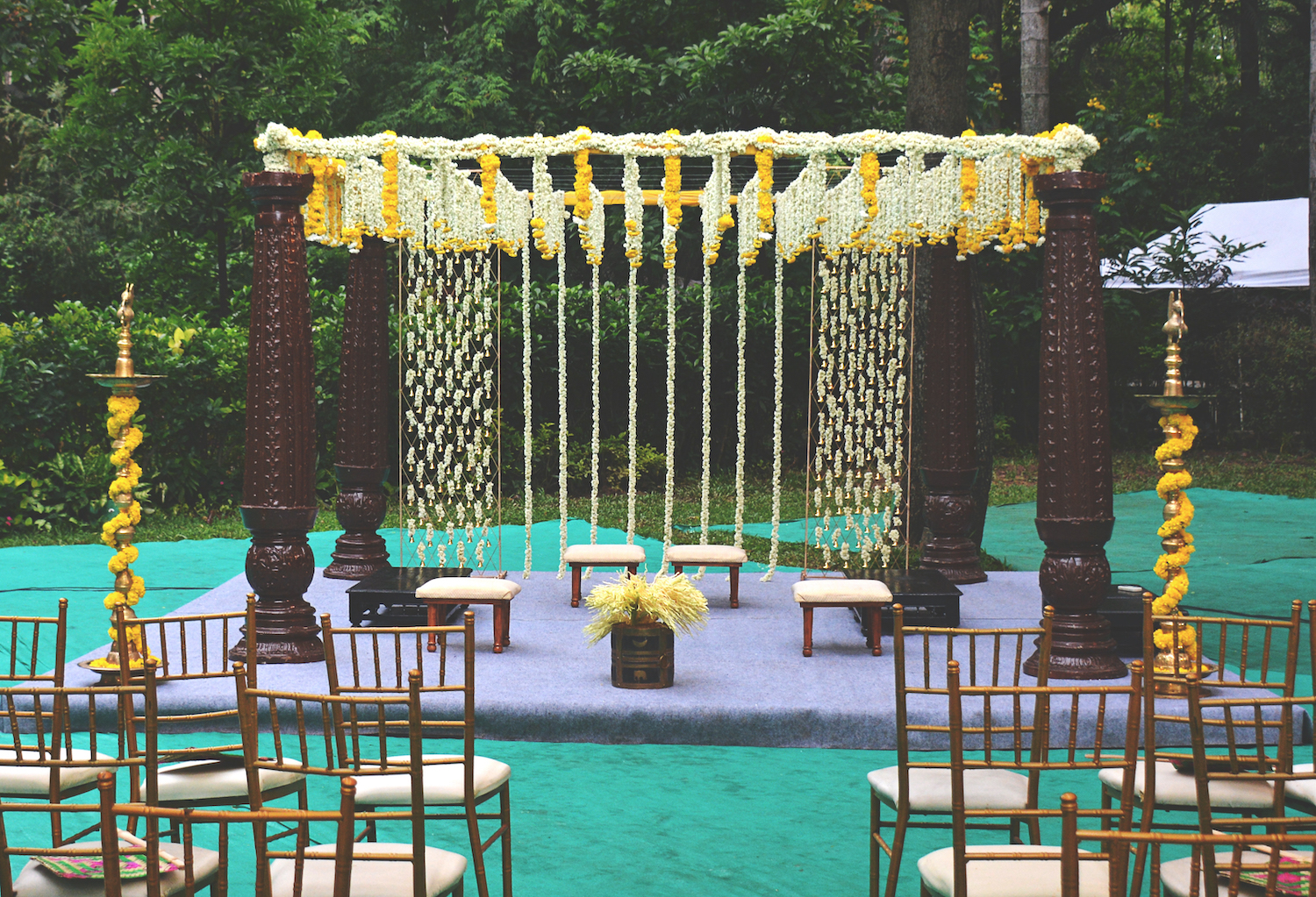 Wooden Mandap Decorated with bells, marigolds & tuberoses for south Indian wedding