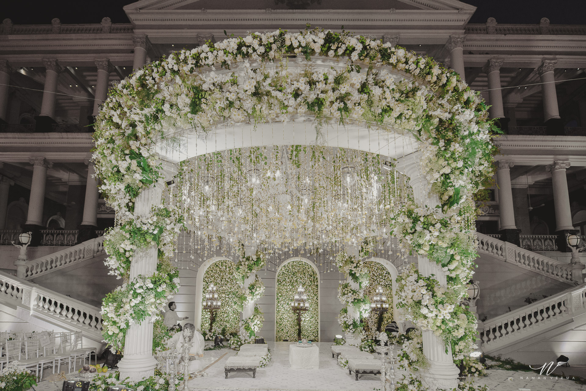 crystal wedding mandap decoration with white flowers and greenery