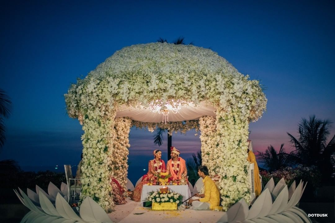 dome shaped white mandap with flower decoration