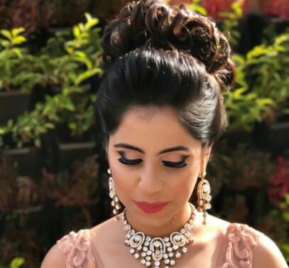 top knot, bridal bun. bridal hair, bridal makeup