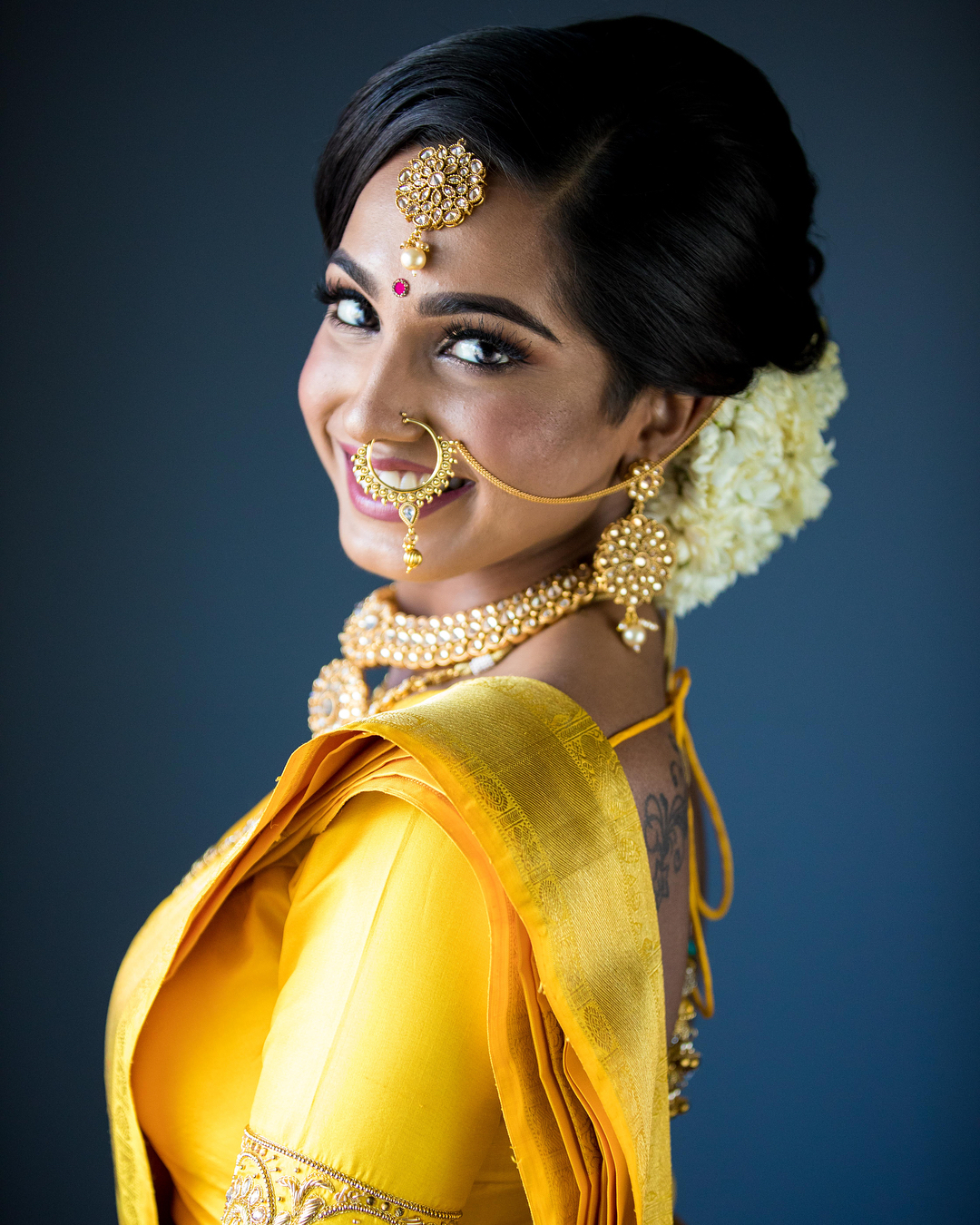 south Indian bridal gold nose ring with a tear-drop stone