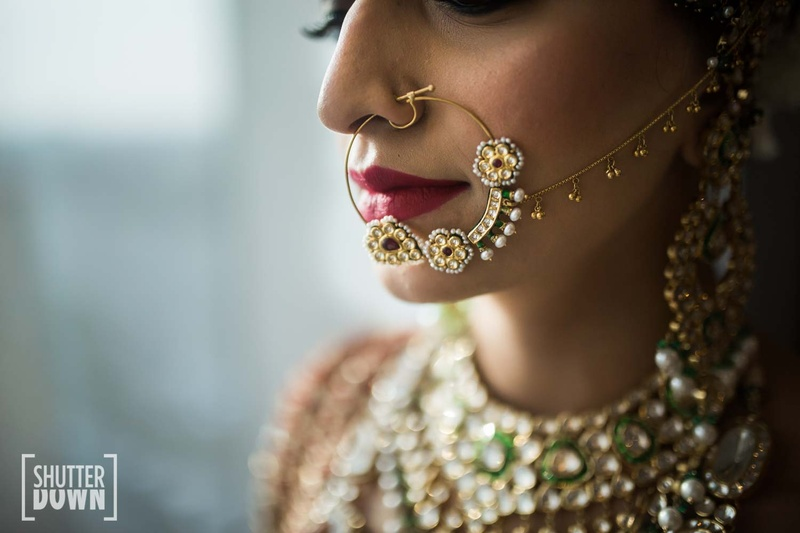 beautiful nathni design with kundan and pearl detailing