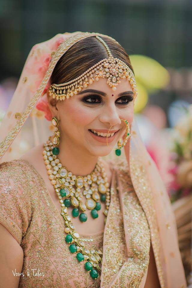 dulhan nath design with kundan work and hint of green colour