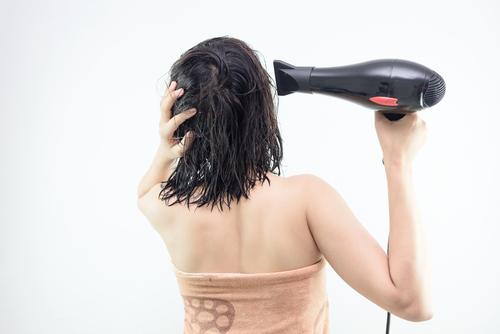 blowdrying hair