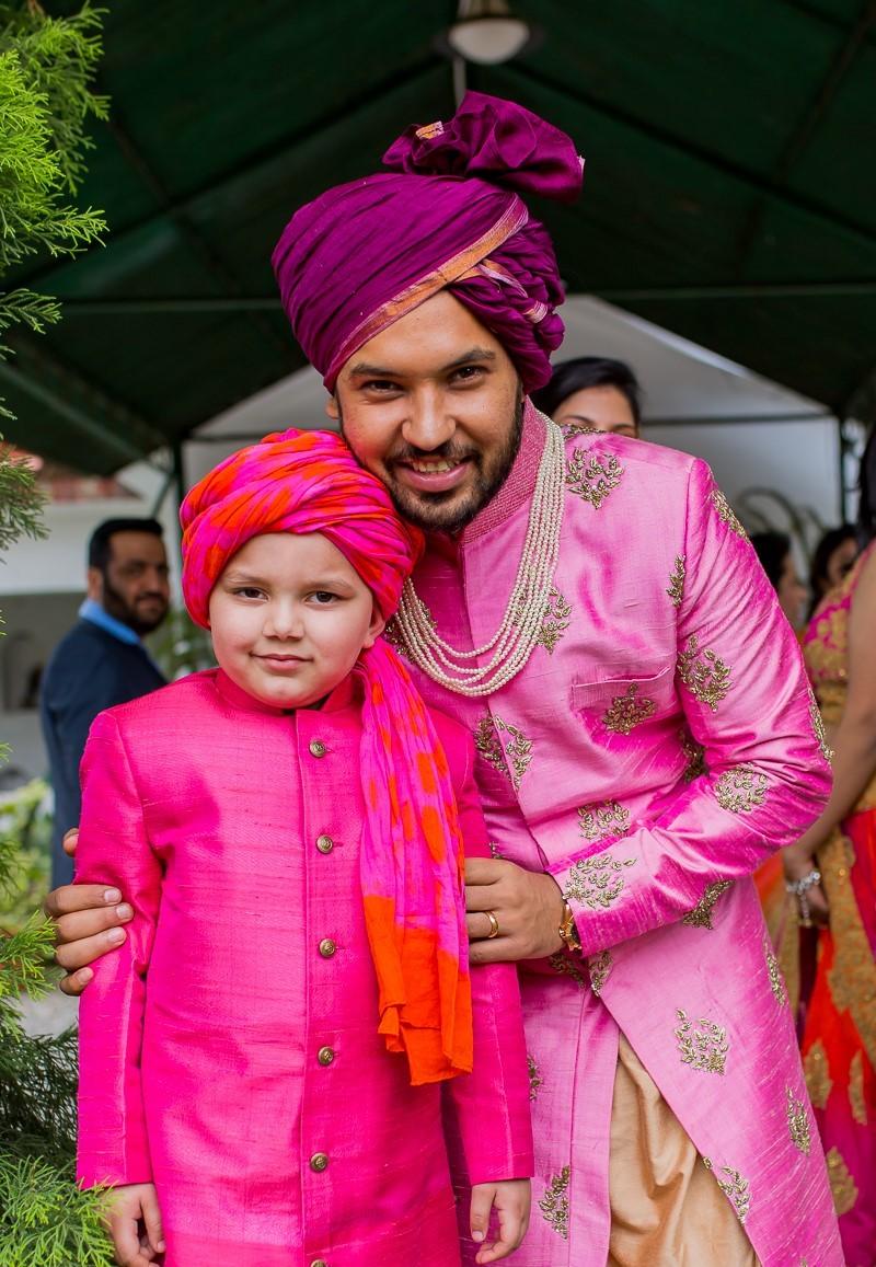 Purple dulha pagdi with pink sherwani and sarbala in pink & orange tie dye safa - pink silk dresses for men for wedding