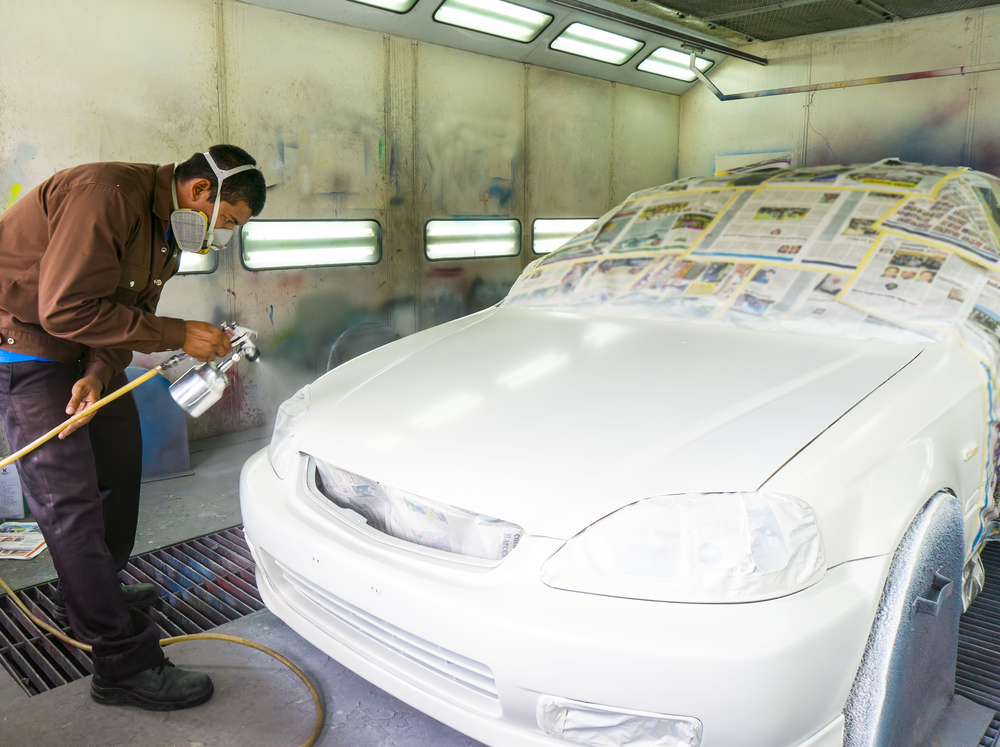 man painting the car body