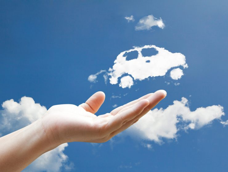 man holding a car shaped cloud