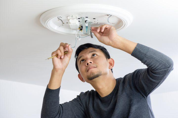 man fixing a bulb
