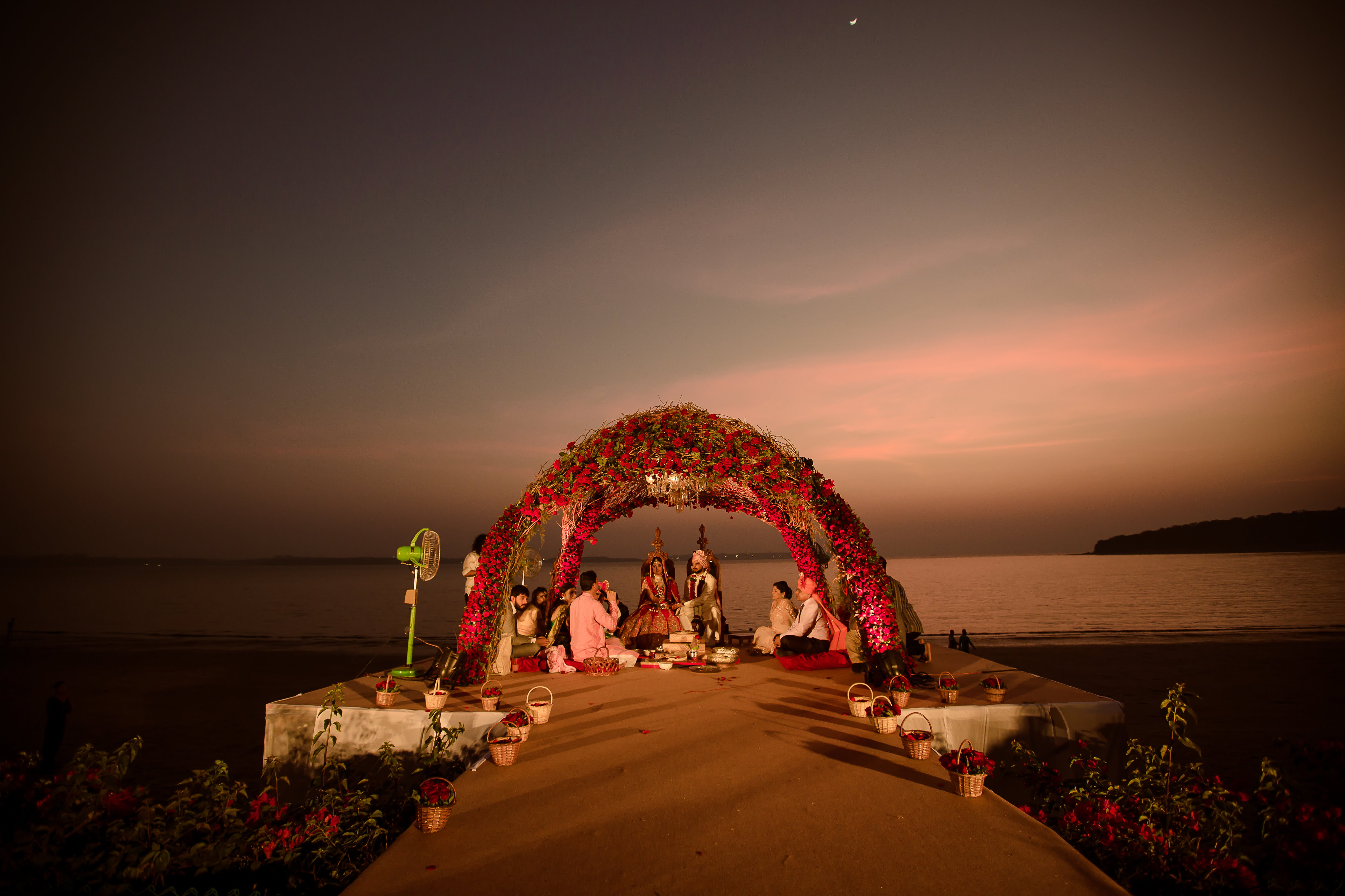 latest wedding mandap design for beach wedding decorated with Red Roses & Rustic Come