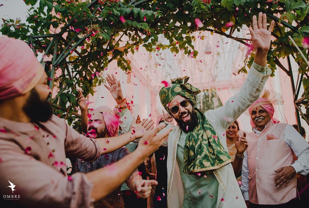 green wedding pagri on groom in printed stiff fabric - unique design