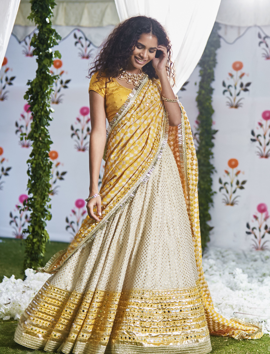 Yellow and White Bridal Lehenga- Abhinav Mishra, Shahpur Jat Boutiques.