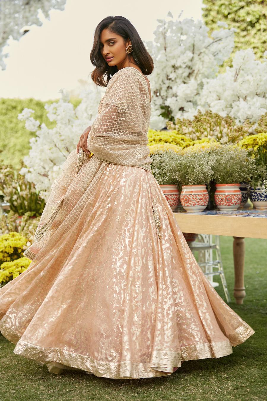 Pale peach Bridal Lehenga- Abhinav Mishra, Shahpur Jat Boutiques.