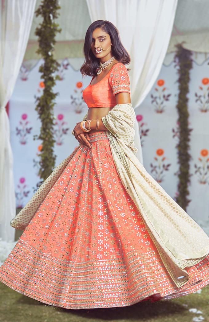 Orange Bridal Lehenga- Abhinav Mishra, Shahpur Jat Boutiques.