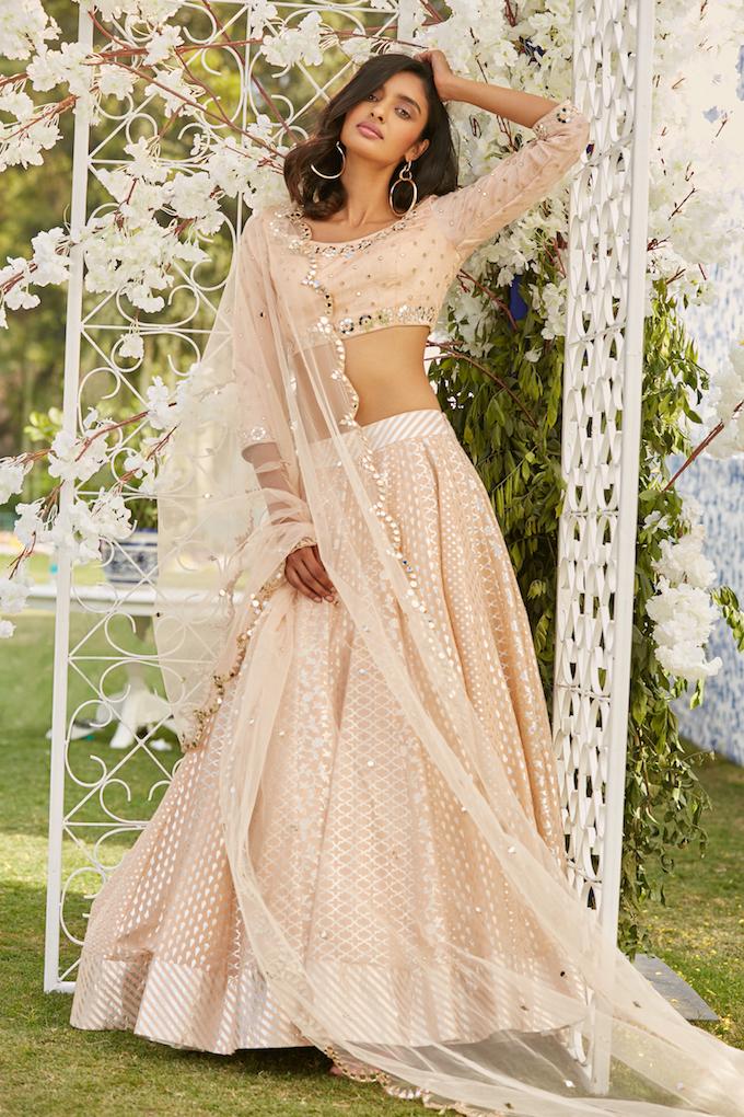 Pale peach Bridal Lehenga with Mirror work- Abhinav Mishra, Shahpur Jat Boutiques.
