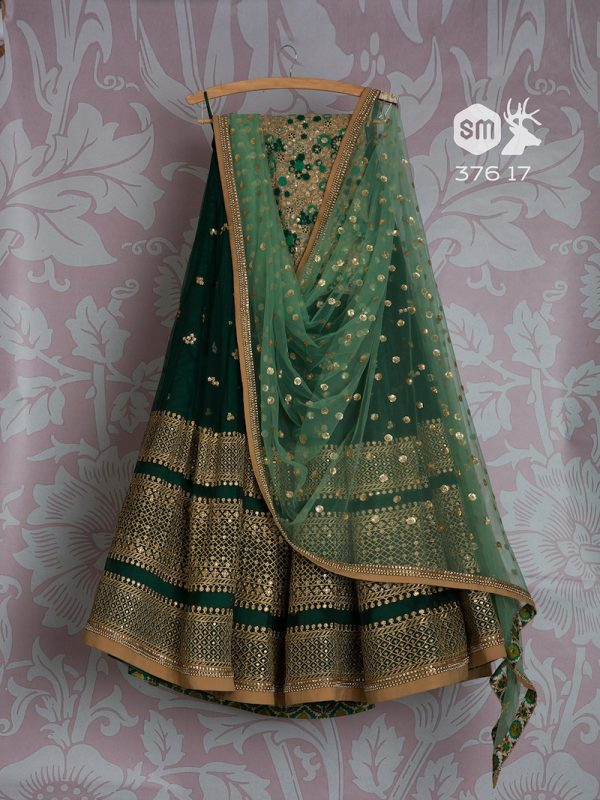 Bottle green lehenga with heavy work on border