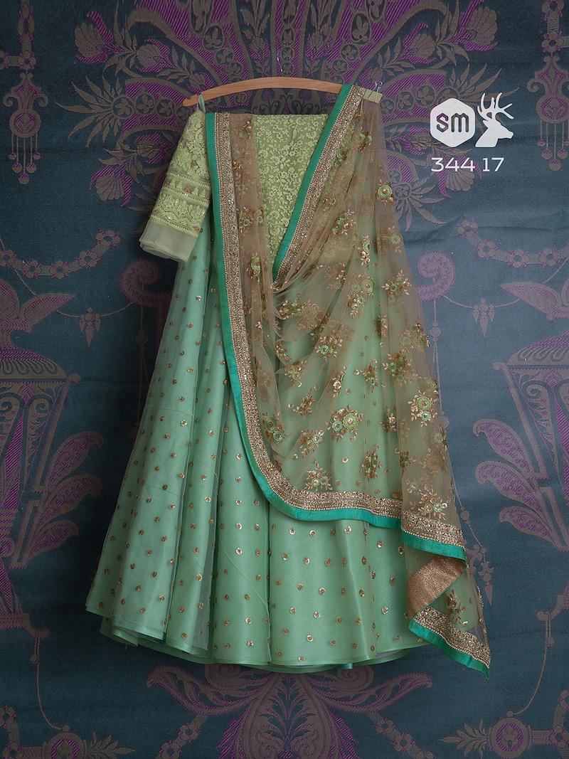 Bluish green lehenga with pista green blouse by Swati Manish