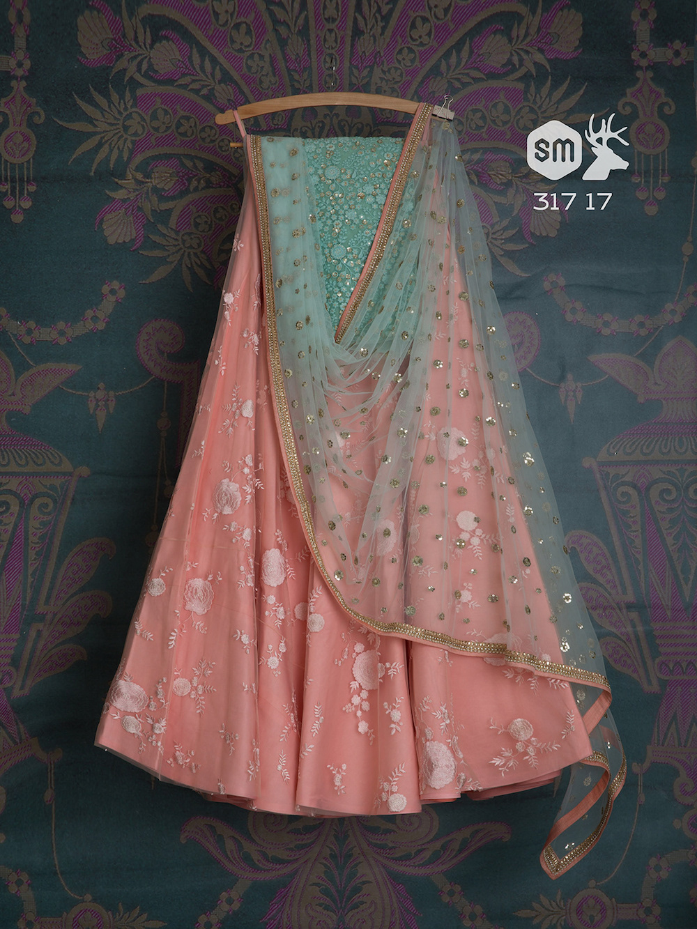 Bridesmaid - Light pink lehenga with light blue embroidered blouse