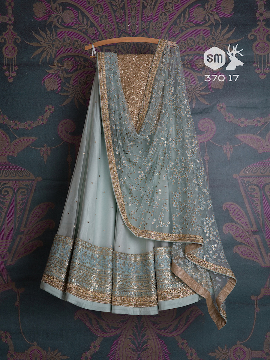 Blue pastel light lehnga with big border and sequin blouse