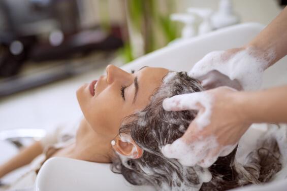 girl shampooing hair