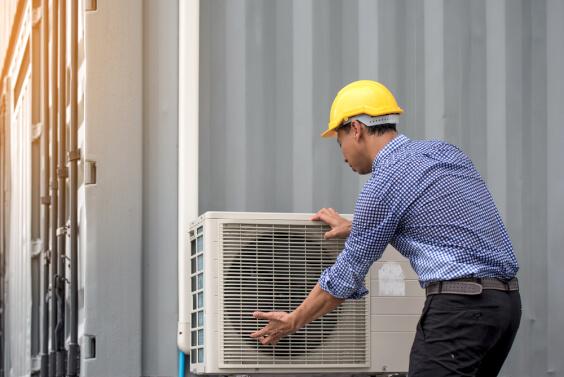man repairing dirty AC unit
