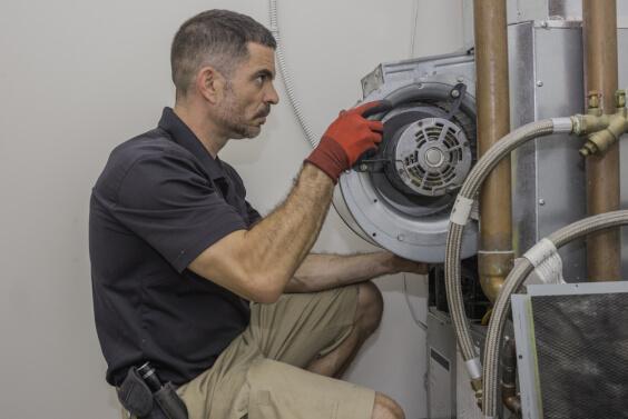 man fixing Ac motor