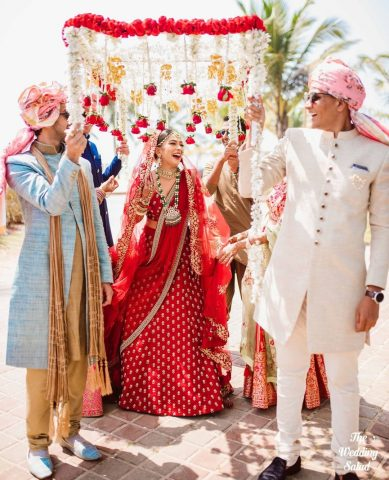 Songs for bridal entry - Indian wedding - bride entering under phoolon ki chaadar with red roses and kaleerey hanging
