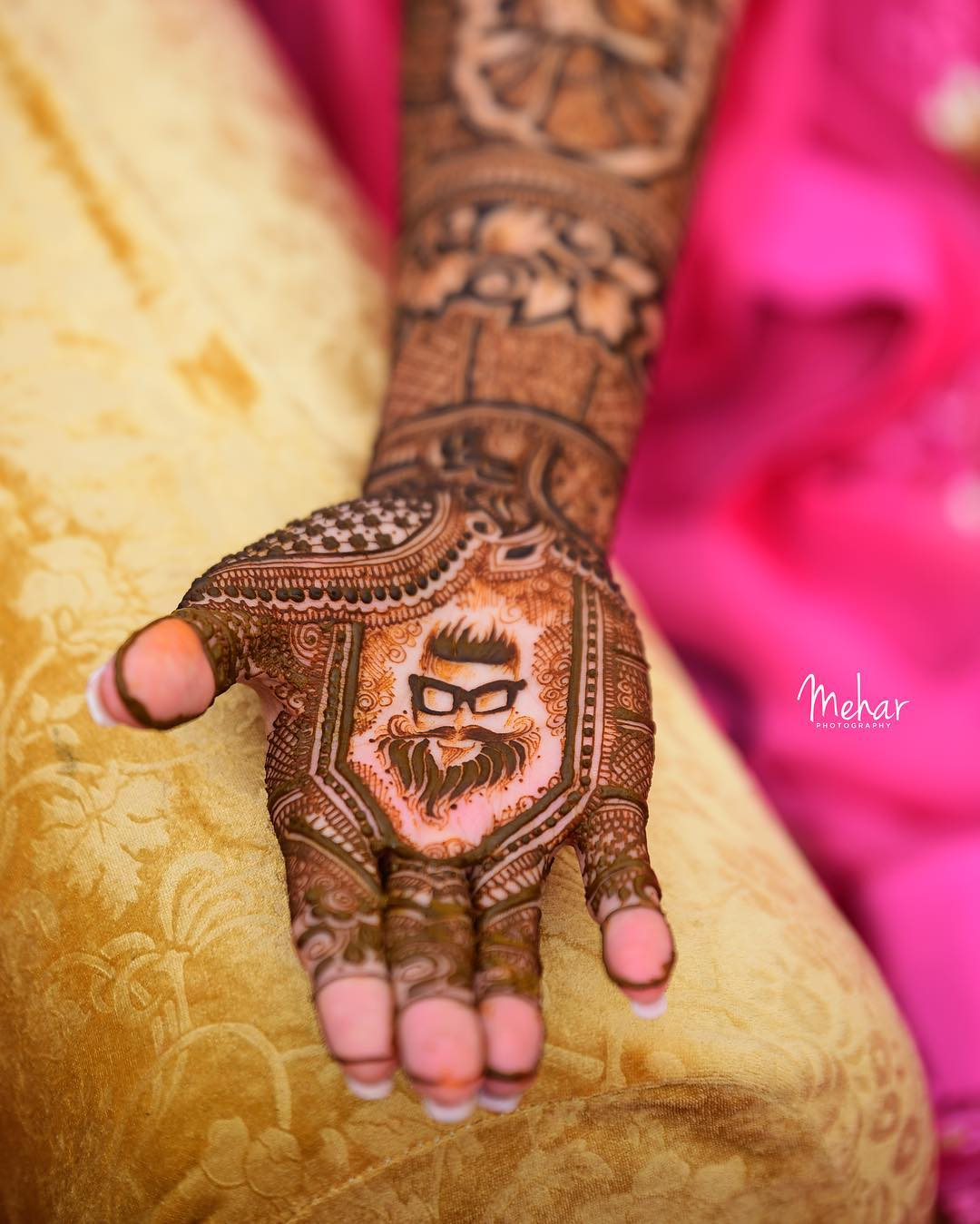 latest bridal mehendi design - adding sketches on the palm of your full hand henna to make it unique